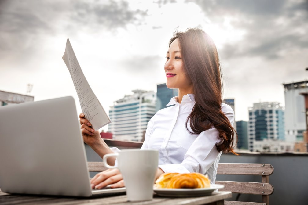 A picture of a woman working remotely